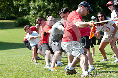 Adults Pull Rope In Team Tug-Of-War Competition Editorial Stock Image