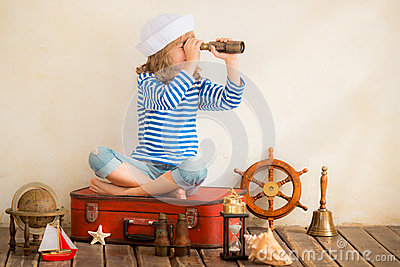http://thumbs.dreamstime.com/x/adventure-travel-concept-happy-child-playing-vintage-nautical-things-kid-having-fun-home-summer-sea-dream-imagination-51681382.jpg