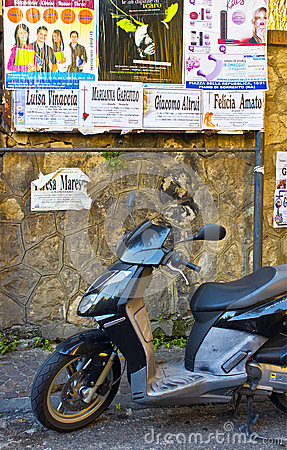 Advertising Posters and Motor Scooter, Italy Editorial Image