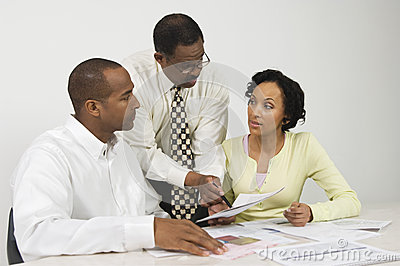 Advisor Explaining Financial Plans To Couple