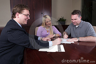 Advisor reviewing contract with clients