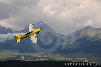 Aerial acrobatics in mountains -  weer airplane