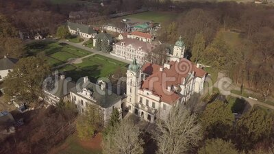 Aerial autumn view to Zamoyski Palace in Kozlowka near Lublin, Poland. Aerial autumn view to Zamoyski Palace in Kozlowka. Rococo and neoclassical palace complex stock footage