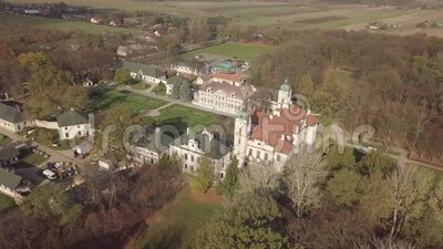 Aerial autumn view to Zamoyski Palace in Kozlowka near Lublin, Poland. Aerial autumn view to Zamoyski Palace in Kozlowka. Rococo and neoclassical palace complex stock video