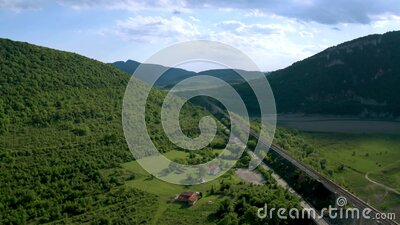 A picturesque valley with a drying dam and bridges stock footage