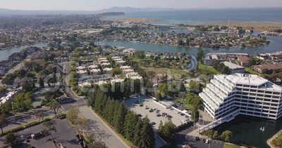 Aerial drone footage of san mateo suburbs riverside with ocean in background near playstation HQ. In california, united states stock video