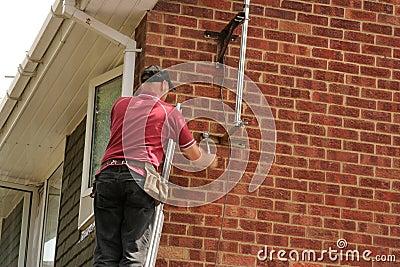 Aerial fitter on ladder