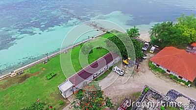 Aerial Fly-Over View of Historical Hiszpański Landmark Ruins in the Calm Blue Ocean Beach in Cebu, Filipiny zbiory