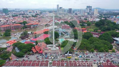 Aerial Orbiting Parallax Taming Sari Tower Malacca Malaysia Bandar Hilir With Melaka River View And Giant Ship Maritime Museum 4K. This video is about Aerial stock footage
