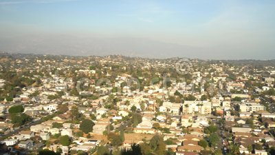 Aerial view of the cityscape of Highland Park. Aerial pan shot of the cityscape of Highland Park, Los Angeles, California, United States stock video footage