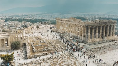 Aerial view of crowded tourist place near the Parthenon temple on Acropolis in Athens, Greece. Aerial shot of crowded tourist place near the Parthenon temple on stock video footage