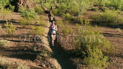 Aerial Shot of Trail Runners in Arizona Sonoran Desert Surrounded by Saguaros. Aerial Shot of Trail Runners in Rugged Arizona Sonoran Desert Surrounded by stock footage
