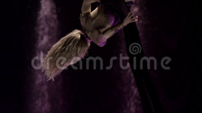 Aerial silk gymnast. Female gymnast performing on aerial silk in circus. Exciting acrobatic show stock video footage