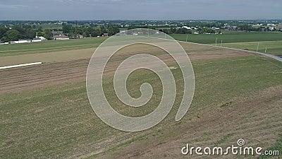 Amish Farmer Seeding His Field with 6 Horses  Barn, building