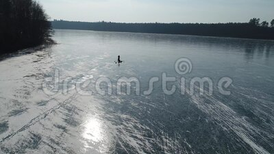 Aerial view of anglers on a frozen lake stock footage