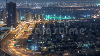 Aerial view of apartment houses and villas in Dubai city night timelapse, United Arab Emirates. Aerial view of apartment houses and villas in Dubai city night stock video footage