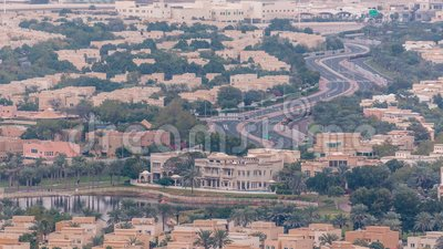 Aerial view of apartment houses and villas in Dubai city timelapse, United Arab Emirates. Aerial view of apartment houses and villas in Dubai city timelapse near stock footage
