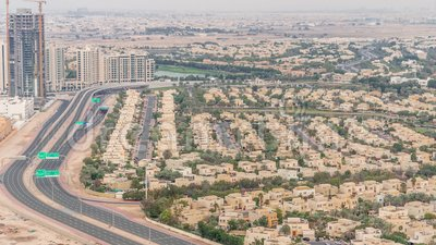 Aerial view of apartment houses and villas in Dubai city timelapse, United Arab Emirates. Aerial view of apartment houses and villas in Dubai city timelapse near stock video