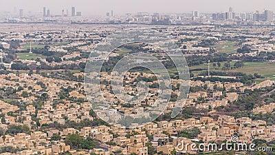 Aerial view of apartment houses and villas in Dubai city timelapse, United Arab Emirates. Aerial view of apartment houses and villas with golf course in Dubai stock video