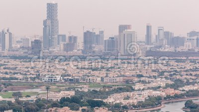 Aerial view of apartment houses and villas in Dubai city timelapse, United Arab Emirates. Aerial view of apartment houses and villas in Dubai city timelapse near stock video footage