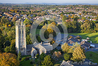 Aerial view of a British village with church and school