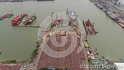 Cargo and passenger seaport in surabaya, java, indonesia. Aerial view cargo and passenger seaport with ships and crane Tanjung Perak, surabaya, indonesia. docks stock video