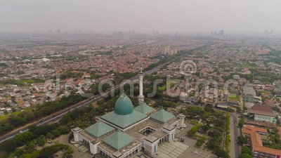 Mosque Al Akbar in Surabaya Indonesia. Aerial view cityscape city Surabaya with mosque Al Akbar, highway, skyscrapers, buildings and houses. mosque in Indonesia stock footage