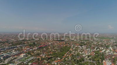 Aerial view denpasar city, Indonesia. Aerial view denpasar city located in Bali Indonesia. asian town with buildings, highway at sunset time stock footage