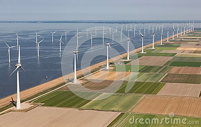 Aerial view Dutch landscape with offshore wind turbines along coast Stock Photo