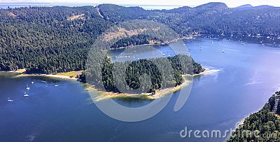 An aerial view from a float plane of montague bay on the tree covered Galiano island in the Gulf Islands of British Columbia Stock Photo
