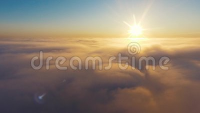 Aerial View. Flying in fog, fly in mist. Aerial camera shot. Flight above the clouds towards the sun. Misty weather. View from above. Birds point of view