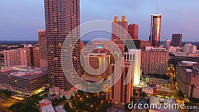 Aerial view flying over downtown Atlanta at dusk  Atlanta, Georgia, camera  moves rising up