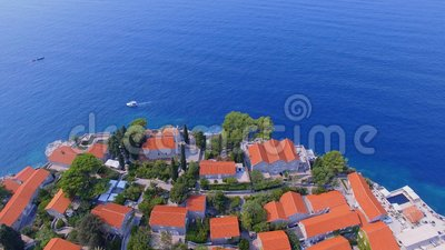 Aerial view of hotels on the island, Montenegro, Sveti Stefan 10. Drone shot of hotels on the island, Montenegro, Sveti Stefan 10 stock video footage