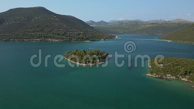 Aerial view of Mali Ston Bay. Aerial view of the Island of life in Mali Ston Bay with a small fishing village stock footage