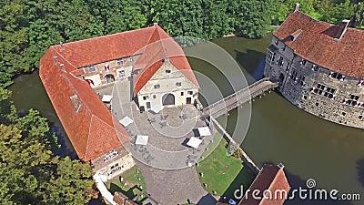 Aerial view of the medieval castle Vischering in Luedinghausen, Germany stock video