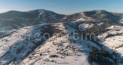 Aerial view of a mountain village. Winter landscape. Drone footage snow covered trees, winter nature. Carpathian Mountains, Ukraine.Drone footage snow covered stock footage