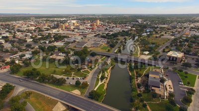Aerial View Moving over The River in Downtown San Angelo West Texas. Just slight traffic on the weekend in the aerial view of San Angelo Texas USA stock video footage