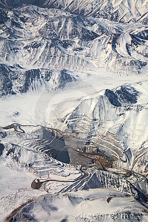 Aerial view of open-pit mine under snow, Chile