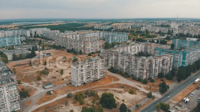 Aerial view of Residential multi-storey buildings in the city. Housing area. The drone flies over the roofs of the houses above the roads and the forest stock video