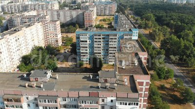 Aerial view of Residential multi-storey buildings in the city. Housing area. Urban infrastructure. The drone flies over the roofs of the houses above the roads stock video