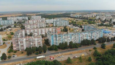 Aerial view of Residential multi-storey buildings in the city. Housing area. The drone flies over the roofs of the houses above the roads and the forest stock video footage