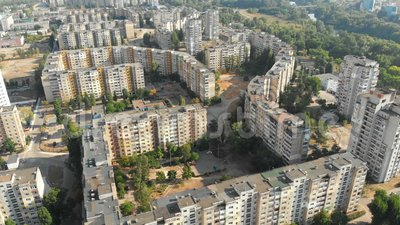 Aerial view of Residential multi-storey buildings in the city. Housing area. Urban infrastructure. The drone flies over the roofs of the houses above the roads stock video footage
