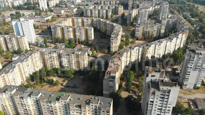 Aerial view of Residential multi-storey buildings in the city. Housing area. Urban infrastructure. The drone flies over the roofs of the houses above the roads stock footage