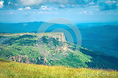 Aerial view Rocky Mountains landscape with clouds sky