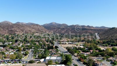Aerial view of small city Poway in suburb of San Diego County. California, United States. Small road and houses next the valley during dry summer season stock video footage