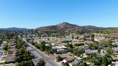 Aerial view of small city Poway in suburb of San Diego County. California, United States. Small road and houses next the valley during dry summer season stock footage