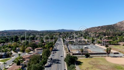 Aerial view of small city Poway in suburb of San Diego County. California, United States. Small road and houses next the valley during dry summer season stock video