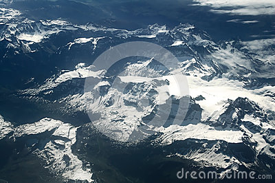 Aerial view of the snow Alps mountains. Europe.