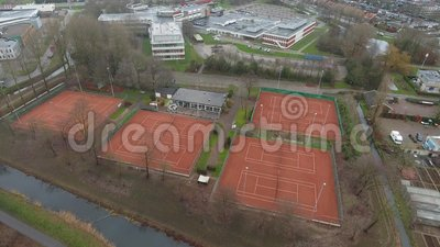 Tennis courts aerial view , Zwijndrecht, Netherlands. Aerial view of tennis courts, cloudy day light in Zwijndrecht, Netherlands stock footage