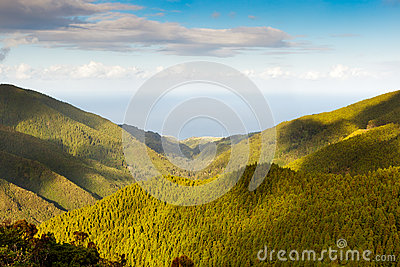 Aerial view to the Atlantic ocean over mountains